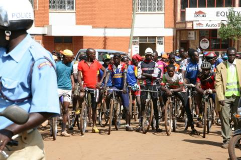 Riders line up at the start in downtown Kitale